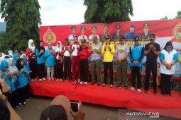 Meriahkan HUT Bhayangkara, ribuan peserta ikuti gerak jalan di Palas