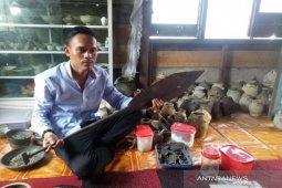 Kisah penyelam Sungai Musi, pemburu harta karun Sriwijaya
