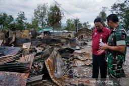 TNI-Polri serta masyarakat kerja bakti setelah kerusuhan Wamena