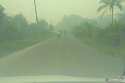 Kabut asap di Kota Jambi makin pekat di pagi hari