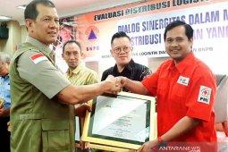 PMI dapat pengharaan BNPB atas kontribusi pendistrubusian logistik