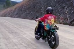 President Jokowi reviews border road construction aboard custom motorcycle