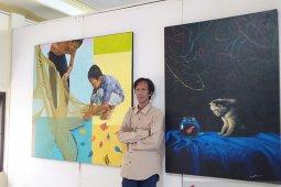 Pelukis Ahmad Noor dengan sebuah karya senilai Rp25 juta