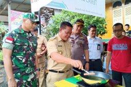 PLN dukung pedagang kuliner Kampung Sentana gunakan kompor induksi