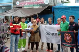 Adaro and partners distribute assistance for flood victims