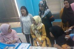 Parmi senang ikut layanan MKJP BKKBN di kebun sawit Malaysia