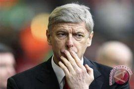 "Arsene Wenger akan ""terkejut"" jika ia tetap di Liga Inggris"