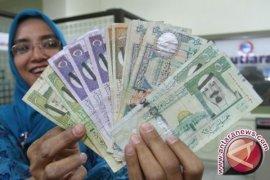 Kiriman Uang TKI Karawang Rp2,8 Miliar Per Bulan