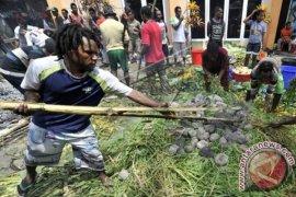 Bakar Batu Mahasiswa Papua