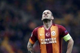 Pemain Belanda Wesley Sneijder gantung sepatu
