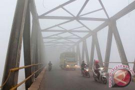 Maskapai rugi ratusan juta akibat asap