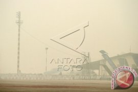 'Asep Melawan Asap' Di Bandung