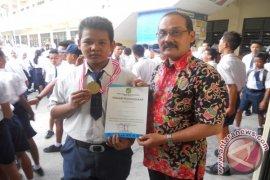 Sandi Harahap Siswa SMP Pahlawan Nasional Juara Gulat