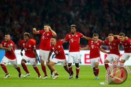 Bayern Muenchen ke perempat final dengan keunggulan 8-1
