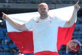 Bantu penderita kanker, atlet Polandia jual medali olimpiade
