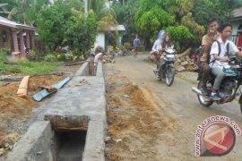 Desa Bandar Jawa Simalungun Bangun Parit Pasangan