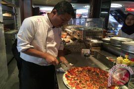 Trik agar adonan pizza tidak mudah sobek