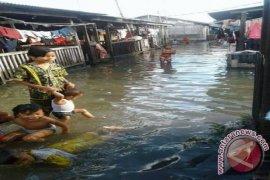 Banjir Rob Genangi Kota Tanjung Tiram