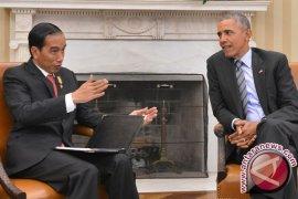 """Obama Diajak Naik """"Bogey"""" dan Makan Sore"""