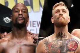 Mayweather dan McGregor akan tuntaskan perseteruan di ring