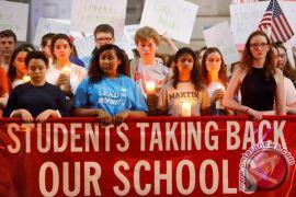 Trump usul guru di AS dipersenjatai