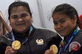 Pelatih angkat besi: emas dari Nurul dan Melinda mengejutkan