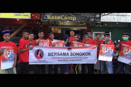 Songkok kubu raya sosialisasikan Karolin-Gidot kepada masyarakat