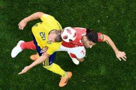 Tiket perempat final untuk Swedia, Swiss pulang