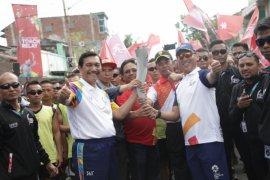 Telkomsel Sukseskan Pawai Obor Asian Games 2018 di Mataram