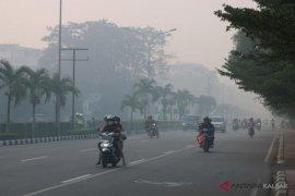 Mencoba hidup berdamai dengan kabut asap