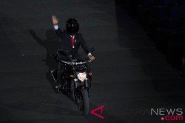 Cerita di balik Jokowi menunggang motor paspampres