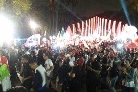 Relawan Jokowi tarikan poco-poco di Tugu Proklamasi