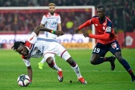 Lyon curi satu poin dari kandang Lille