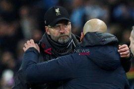 Guardiola dan Klopp bersaing  sebagai kandidat Pelatih Terbaik