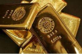 Harga emas turun, ekuitas lanjutkan reli ditopang optimisme perdagangan