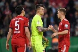 Bermain dengan sepuluh orang, Muenchen ke semifinal Piala Jerman