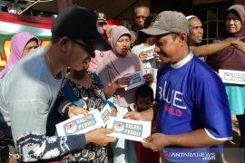 Komunitas Kalsel Peduli dan Mulawarman Peduli bantu korban kebakaran