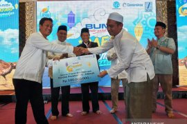 BUMN assistance to build a kitchen for orphan
