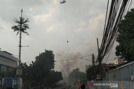 Helikopter guyur air di beberapa lokasi pembakaran