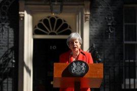 Pesan May kepada Putin: Inggris terbuka hubungan lain dengan Rusia
