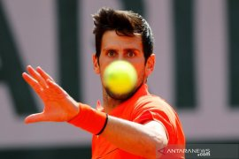 Hujan hentikan pertandingan semifinal Djokovic