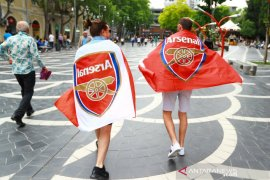 "Fans Arsenal kritik ""kepemilikan pasif"" Stan Kroenke"