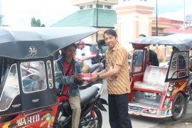 BPJS Kesehatan Gorontalo Bagikan Takjil Untuk Masyarakat