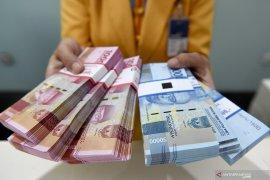 Rupiah menguat seiring turunnya imbal hasil obligasi AS