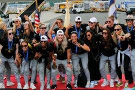 Juara Piala Dunia Putri AS tiba di negaranya