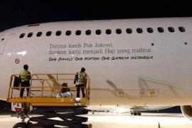 "Ini penjelasan Garuda terkait tulisan ""Terima Kasih Pak Jokowi"" di badan pesawat"