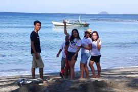 Pantai Lumintang salah satu potensi wisata Minahasa Tenggara Page 1 Small