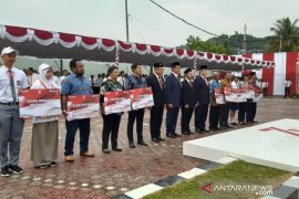 BRI serahkan bantuan sosial  Rp1 miliar lebih untuk masyarakat Papua dan SMN Page 1 Small