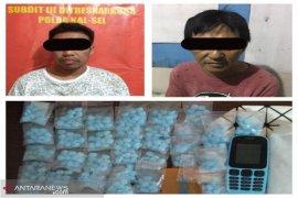Dua pengedar sabu-sabu dan ratusan pil ekstasi diringkus