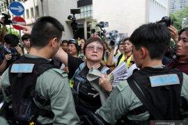 Pengunjuk rasa Hong Kong berencana kacaukan bandara pada Minggu
